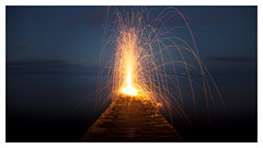 Krakatoa (picturedevon.co.uk) Tags: dawlish teignbridge devon england uk le seascape night sky stars fire wirewool steelwool longexposure lights orange yellow blue red white astro nightscape motion jetty volcano clouds summer dark wwwpicturedevoncouk photography