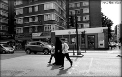 `2049 (roll the dice) Tags: london londonist w2 westminster edgwareroad muslim arab mad sad funny people surreal streetphotography traffic crossing cars fashion shops shopping dark kids bank burka niqab eyes scarey creepy portrait strangers candid banned arabic shadows uk art classic urban unaware unknown uae oil veiled hijab peek