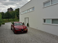 IT REALLY IS A RELIGIOUS EXPERIENCE (iBSSR who loves comments on his images) Tags: modern architecture minimalist bellezza necessaria casa haus villa bssr house driveway white gravel alfa 2017 romeo giulia veloce plain space design dutch italy ribbon windows lecorbusier architect red living park mynewcar review