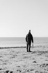 Where are you? (lorenzoviolone) Tags: cold d5200 dslr fomapan 100 man nikon rni films reflex alone beach hat headland horizon water roadtrip:tuscany=jan2017 sand streetphoto streetphotobw streetphotography winter fomapan100 nikond5200 rnifilms horizononthewater castiglionedellapescaia toscana italy