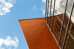 Corner (Karen_Chappell) Tags: corner sky tilt angle orange blue glass building geometry geometric architecture stjohns newfoundland conventioncentre mirror clouds nfld avalonpeninsula city urban abstract canada atlanticcanada downtown rectangle shape reflection