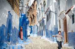 STREET BOY (Dan ODonnell) Tags: morocco boy stairs chefchaouen woman blue shadow running travel street backpacking africa adventure youth dan odonnell steps