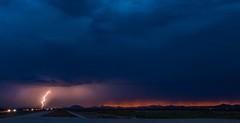 A sunset and a lightning strike