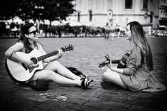 Music and smile (Dalibor Papcun) Tags: guitar music mono monochromat blackandwhite bw prague praha street stphotography musicians woman people 50mm citylife