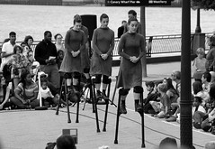 Ladies doing it on stilts (_steve h_) Tags: streetphotography london urban candid sony nex6 gdif 2017 greenwich docklands international festival bw blackandwhite monochrome ladies stilts contemporary dance mulïer