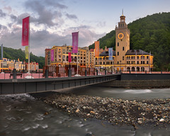 Romanov Bridge and Mzymta River in the Morning, Rosa Khutor, Sochi, Russia (ansharphoto) Tags: architecture bridge building caucasus city cityscape dawn electric embankment foothill hill holiday hotel illuminated khutor krasnaya lamp landmark landscape lights modern morning mountain mzymta nature olympic polyana promenade resort river rosa russia ski sky skyline sochi sport street summer tower town travel twilight urban vacation valley view village water waterfront