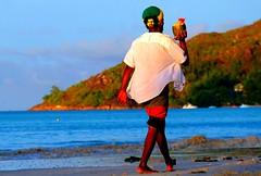 Seychelles, Praslin, Cote d'Or (ClaDae) Tags: praslin cote beach sun water people man coconut walk color seychelles seychellen cotedor happy