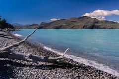 Largo Nordenskjold (robertdownie) Tags: sky landscape lake water nature beach travel rock summer branches mountain cloud blue panoramic aqua outdoors pebble patagonia chile scenic driftwood azure glacial no person