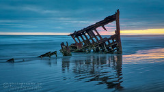 Sunset at Peter Iredale 1 (Jerry Fornarotto) Tags: abandoned beach boat clouds coast decay disaster dramatic historical iredale iron jerryfornarotto landscape longexposure moody northwest oceansunset old oldship oregon oregoncoast outdoors pacific pacificnorthwest peteriredale reflection remains ruins rust rusted scene sea ship shipwreck shore skeleton sky steel storm sunset travel vessel warrenton water waves west western wm wreck