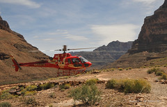 Helicopter landing (Vee living life to the full) Tags: nikond300 2017 holiday travel tourism tourist placestovisit traveller pleasure usa california leisure sky blue clouds dry hot haze walking driving temperature 80degreesplus nevada utah arizona distance layers limestone sandstone water evaporation disintegration weathering leger erosion roads route american vehicle rocks rock cliff sheer drop mountains skyline horizon sitting geology sedimentary compression uplift wild road formation helicopter pilot flying flight plane aeroplane skytours grandcanyonhelicopters grand canyon
