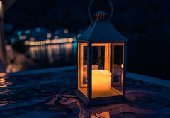 candle (A & A McKee) Tags: candle light bokeh table sea water reflection beautiful night summer loutro crete greece nikon dslr sigma 1835mm 18 d500 dark evening autoremovedfrom1to5faves