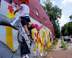 NoDa Wall Artists with Broken Leg (Philip Osborne Photography) Tags: noda wall artists brokenleg cast charlotte nc summer hat heat spraypaint cans