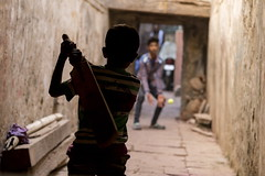 Playing the game (alfienero) Tags: sport cricket game children india varanasi playing play ball street reportage