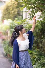 Young woman stretching hand to green leaves (Apricot Cafe) Tags: img660997 asia asianandindianethnicities canonef85mmf18usm harajuku healthylifestyle japan japaneseethnicity tokyojapan beautifulwoman carefree charming cheerful colorimage day elegance enjoyment greencolor happiness humanhand lifestyles longhair nature oneperson onlyjapanese onlywomen onlyyoungwomen outdoors people photography raising reaching smiling street summer threequarterlength vertical women youngadult