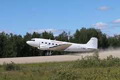 Basler BT-67 take off at Fort Hope Airport. (gangecon) Tags: northstarair pilot northwesternontario ontario canonef70300mmf456lisusm canon70300mm fly flying sunny gravelairstrip gravel airstrip dust sunshine canon80d forthope takeoff takingoff aircraft airport airplane dc3 baslerbt67
