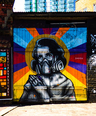 Gas Masks Optional (Steve Taylor (Photography)) Tags: zaeou gasmask rainbow aerosol halo can spray door art graffiti mural streetart vivid paint wooden lady woman uk gb england greatbritain unitedkingdom london contrast colourful