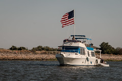 D17962E7 - Amazing Grace Approaches Raft Up (Bob f1.4) Tags: water houseboat boat recreational leisure giant huge american flag board 4th july hilton fireworks californai ca sacramento delta waterway