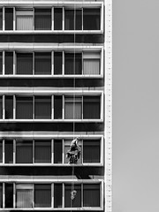 Hanging Out (ep_jhu) Tags: limpiando x100f window windows fujifilm ventana man hombre spain barcelona windowwasher fuji bw rope acros soga españa hanging