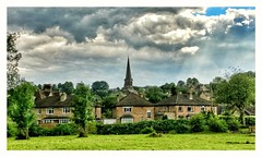 Bakewell All Saints Church seen from Scots Gardens. (Develew) Tags: bakewell derbyshire england derbyshiredales peakdistrictnationalpark allsaintschurch scotsgardens houses trees watermeadows fields clouds sunshine sunrays rayofsunshine