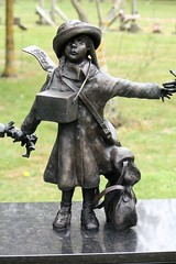 National Arboretum,England - Evacuees - little girl, with gas mask, satchel etc holding hands with other evacuees (rossendale2016) Tags: small girl child jacket wooden wool cost buttons hat strap leather tag name ticket label way which every countryside country raincoat soldiers father mother dad mum family strange bus home miles living strangers parents satchel pigtails enemies enemy two war world german aircraft bombs dangerous safety safe areas centre city from away train toy bear teddy mask gas bag sleeping evacuees england arboretum national