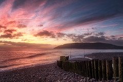 Back To Porlock (Geoff Moore UK) Tags: sea tide morning sunrise dawn water oceac defences stones stone beach wooden stumps aged wood out going horizon city off shore adventure distance landscape coast sky sunset ocean colour warmth waves movement pebbles seascape seaside
