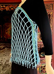 Aquarienne one sleeve (vashtirama) Tags: lacing laced convertible poncho wrap shawl p2p pointtopoint crochetpattern crochetbeachcoverup beads dvpublished lotus summer tunisian hires filet colorwork filter seamfinishing cornerstart tunisiancrochetlace triangle shaped vest lacytunisiancrochet tallstitch beach mermaidy coverup drape mesh net tunisiancrochet filetcrochet lace lacy designingvashtilotusyarn lacingcrochet patterndownloadablepdfmydesign vashtiyarn dorischanyarn beaded seedbeads fringe twistedfringe beadedfringe triangular sidetoside s2s vneck bateau crochetlinenstitch crochetmossstitch crochetseedstitch crochetponcho beachponcho