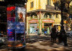 Las Ramblas corner in Barcelona, Spain (` Toshio ') Tags: toshio barcelona spain spanish lasramblas store advertisements people europe european europeanunion city shade light fujixe2 xe2 pharmacy sign architecture