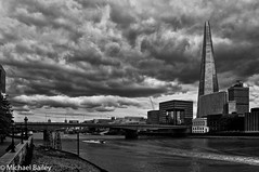 Storm clouds over the Shard!! (MWBee) Tags: riverthames river water theshard clouds londonbridge bridge mwbee nikon d5000 storm blackandwhite monochrome crane gull towerbridge boat rib busses buildings lights hmsbelfast