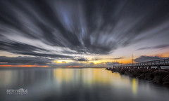 Cloudy Dawn (Beth Wode Photography) Tags: darkclouds sunshine le sunrise morning firstlight wellingtonpoint redlands jetty wellingtonpointjetty pier reflections beth wode bethwode seascape