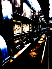The Recycle Yard (Steve Taylor (Photography)) Tags: recycle yard industrial pipes ducting art architecture digital building black blue brown contrast stark spooky eerie metal aluminium steel newzealand nz southisland canterbury christchurch curve perspective texture grungy composter