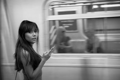 Train Girl (Litratistica Images NYC) Tags: monochromatic portrait monochrome blackandwhite texting innocent people fashion streetphotography thai streetphotographer subway litratisitcaimages usa earldolphy canoneos5dmark2 summer girl nycsubway candid newyorkcity nyc train outdoor colourful model modeling sunglasses pias newyork unitedstates us canonef2470mm