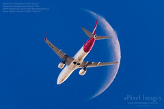 """Qantas VH-VZY Boeing 737 838 """"Temora"""" crosses the waning  crescent moon (ePixel Images) Tags: qantas vhvzy boeing 737838 cn393633944 temora moon waningcrescentmoon brisbane bne boeing737 boeinglovers lunar crescentmoon science flight aircraft brisbaneairport aviation aviationphotography planespotting sky blue astronomy cosmos universe canon"""