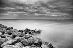 Tiny little breakwater! (karindebruin) Tags: bigstopper breakwater clouds dutch nederland leefilters filters goereeoverflakkee golfbreker holland landscape landschap lucht longexposure langesluitertijden ouddorp sky zuidholland water wolken stenen rocks 06nhhardgrad blackandwhite