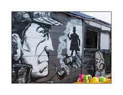 Street Art (Dynamick Art), East London, England. (Joseph O'Malley64) Tags: dynamickart streetartist streetart urbanart publicart freeart graffiti eastlondon eastend london england uk britain british greatbritain art artist artistry artwork jacktheripper jacktheripperterritory folklore myth legend speculation sherlockholmes detective fiction fictionalcharacter shed structure woodenstructure tarpaulins polythene garden urban urbanlandscape aerosol cans spray paint fujix x100t accuracyprecision