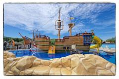 Vakantiepark de Meerpaal (Stan de Haas Photography) Tags: waterpark pool ship playground water boat pirates tippingbucket bucket publicpool fun summer children wet blue sky