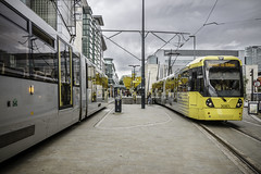 One in one out (tootdood) Tags: canon70d exchangesquare manchester metrolink tram stormy sky black clouds one out track