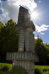 Monument in the sun (Houda94) Tags: monument sun sunrays trees grass greenery green whiteclouds clouds bluesky sky rays