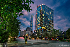 The pedestrian street Nguyen Hue in Saigon, Vietnam (dleiva) Tags: architecture asia blue buildingexterior cathedral christianity church city cloudsky colonialstyle colorimage day famousplace femalelikeness formalgarden frenchculture hochiminhcity humanrepresentation incidentalpeople locallandmark notredamecathedralofhochiminhcity outdoors photography placeofworship religion sky spire spirituality statue sunny symbol tree vertical vietnam vietnameseculture