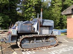 Tractor exhibit (Nekoglyph) Tags: kirkleatham museum redcar cleveland teesside rust metal rnli tractor lifeboat blue old carpark treads caterpillartracks chimney vent exhaust