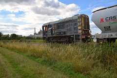 Former British Rail Gronk, 08375 hauls a raft of PCA Cement Hoppers along the private branchline, for the Ketton Cement Plant in the background, which had recently arrived in the Ketton Ward exchange sidings. 14 07 2017 (pnb511) Tags: kettoncement castle cement class08 gronk shunter hopper wagons industrial factory bulk load transport train diesel loco locomotive hanson heidleburgh