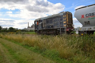 Former British Rail Gronk, 08375 hauls a raft of PCA Cement Hoppers along the private branchline, for the Ketton Cement Plant in the background, which had recently arrived in the Ketton Ward exchange sidings. 14 07 2017