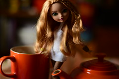 Early Morning Light (jessandgrace) Tags: doll portrait colorimage colors bokeh backgroundblur mug teapot figure legs fishnet dress crochet white face eyes greeneyed hair braids bighair orange blonde strawberryblonde golden ashlynnella everafterhigh eah pretty beauty glamour cute indoor