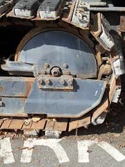 Robot treads (Nekoglyph) Tags: kirkleatham redcar museum cleveland teesside rnli tractor lifeboat blue rust metal old caterpillartracks treads sunlight shadow found face anthropomorphism robot carpark