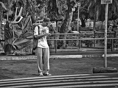 Counting Change (Beegee49) Tags: man standing counting change bacolod city philippines