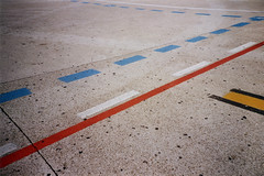 Lines - are they leading anywhere? (ale2000) Tags: analog analogue lca lomo lomography kodakcolorplus kodak film 35mm pellicola filmisnotdead believeinfilm airport aeroporto pavimento floor onthefloor lookingdown lines linee strisce colored coloured concrete cemento travel traveling viaggiare viaggio