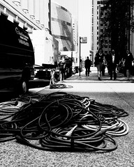 Coiled (RW Sinclair) Tags: 19mm art bw chicago illinois lens sigma sony a6000 alpha blackandwhite bnw city csc digital f28 milc mirrorless monochrome street urban wire wires cable cables sidewalk summer july 2017 白黒 モノクロ モノクロム シカゴ アメリカ