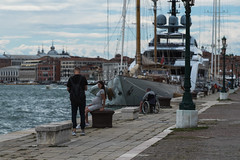 A Pregnant woman, a wheelchair bound fisherman and a super yacht (neilbruder) Tags: italy venice europe2017 fisherman yacht woman pregnant rivadeglischiavoni