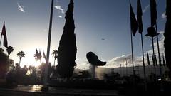 International sunset (Andrés_Parada) Tags: bolivia cochabamba square plaza international flags banderas sky cielo postes fuente water agua city ciudad sunny atardecer sunset
