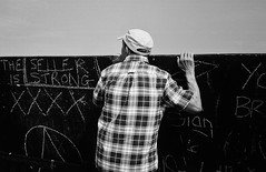 The Seller is Strong (copperknob2011) Tags: broadstairs jetties caps checks bw signs graffiti chalkboard olympustrip monicaweller