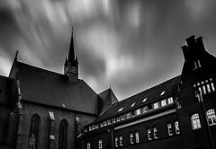 Church in the storm (kaistaudinger) Tags: kirche datteln christen himmel sky wolken wolke gebäude uhr schwarz weis black white canon 18270mm tamron germany nrw wind langzeitbelichtung nd filter